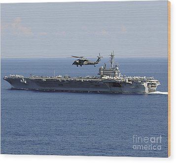An Mh-60s Seahawk Helicopter Flies Wood Print by Stocktrek Images
