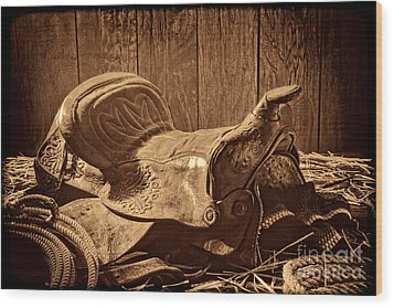An Old Saddle Wood Print by American West Legend By Olivier Le Queinec