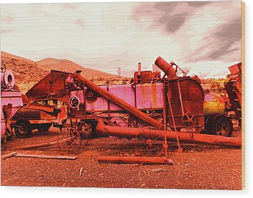 Wood Print featuring the photograph An Old Rusty Harvestor by Jeff Swan