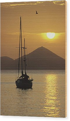 Anchored Ketch And Sunset Over Caribbean Wood Print by Don Kreuter