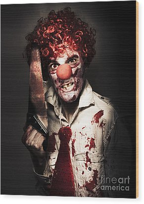 Angry Horror Clown Holding Butcher Saw In Darkness Wood Print by Jorgo Photography - Wall Art Gallery