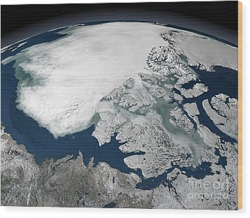 Arctic Sea Ice Above North America Wood Print by Stocktrek Images