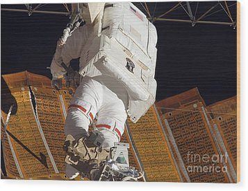 Astronaut Installs Stabilizers Wood Print by Stocktrek Images