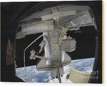Astronaut Participates In A Spacewalk Wood Print by Stocktrek Images