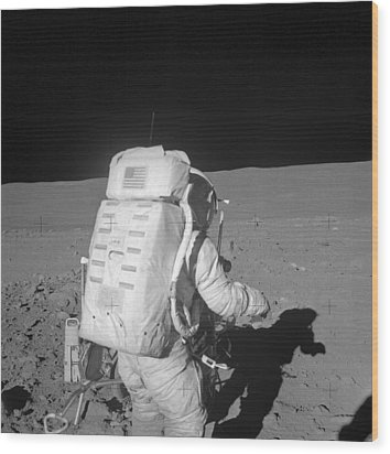Astronaut Walking On The Moon Wood Print by Stocktrek Images