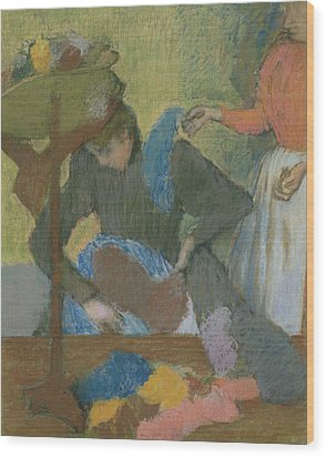At The Hat Maker Wood Print by Edgar Degas
