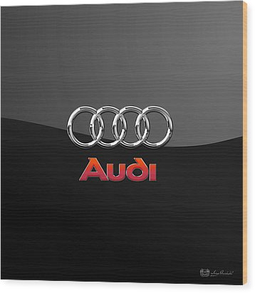 Audi 3 D Badge On Black Wood Print by Serge Averbukh