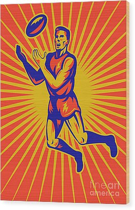 Aussie Rules Player Jumping Ball Wood Print by Aloysius Patrimonio