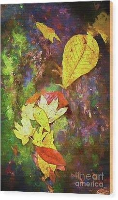 Autumn Leaves On Mossy Tree Trunk Ap Wood Print by Dan Carmichael