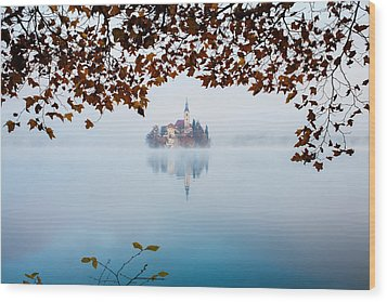 Autumn Mist Over Lake Bled Wood Print by Ian Middleton