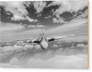 Wood Print featuring the digital art Avro Vulcan Head On Above Clouds by Gary Eason