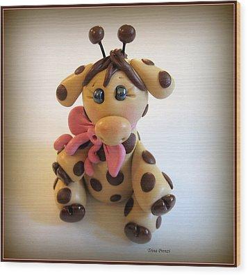 Baby Giraffe Wood Print by Trina Prenzi