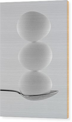 Balancing Eggs Wood Print by Gert Lavsen