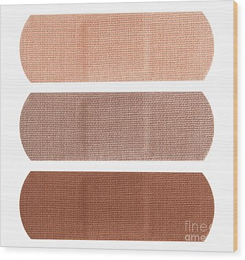 Bandages In Different Skin Colors Wood Print by Blink Images