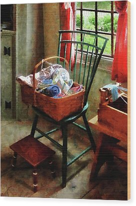 Basket Of Cloth And Yarn On Chair Wood Print by Susan Savad