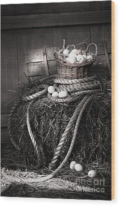 Basket Of Eggs On A Bale Of Hay Wood Print by Sandra Cunningham