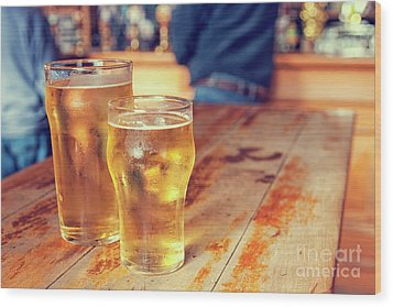Wood Print featuring the photograph Beers In A Pub by Patricia Hofmeester