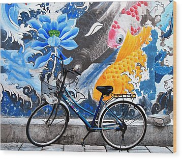 Bicycle Against Mural Wood Print