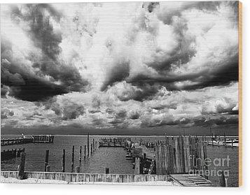 Big Clouds Little Dock Wood Print by John Rizzuto