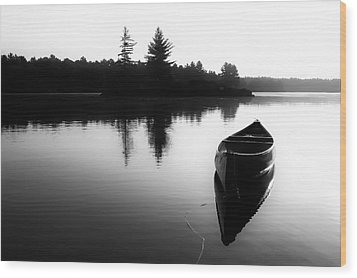 Black And White Canoe In Still Water Wood Print