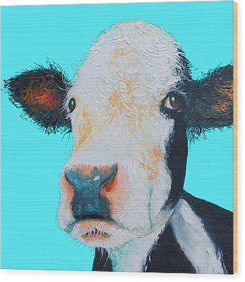 Black And White Cow On Blue Background Wood Print by Jan Matson