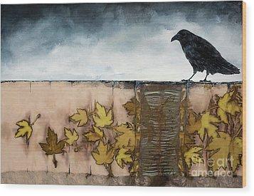 Black Raven Sits Above Scattered Leaves Wood Print by Carolyn Doe