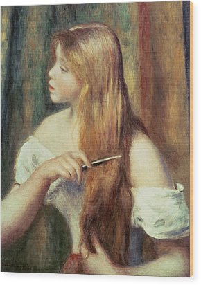 Blonde Girl Combing Her Hair Wood Print by Pierre Auguste Renoir