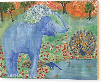 Blue Elephant Squirting Water Wood Print by Sushila Burgess