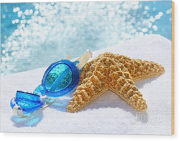 Blue Goggles On A White Towel  Wood Print by Sandra Cunningham