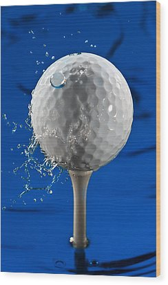 Blue Golf Ball Splash Wood Print by Steve Gadomski
