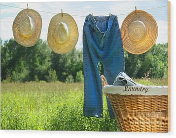 Blue Jeans And Straw Hats On Clothesline Wood Print by Sandra Cunningham