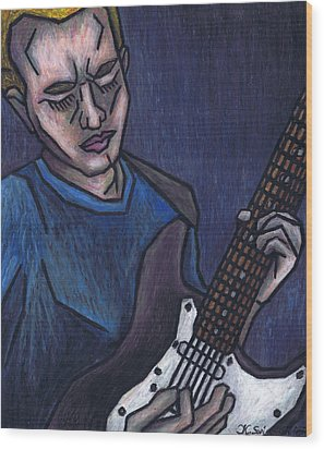 Blues Player Wood Print by Kamil Swiatek