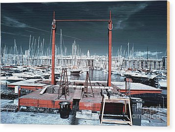 Boat Lift In The Port Wood Print by John Rizzuto