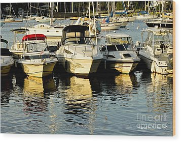 Boats Reflected Wood Print by Carol F Austin