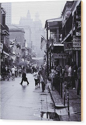 Wood Print featuring the photograph Bourbon Street In The Rain by Ray Devlin