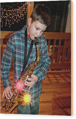 Boy Playing The Saxophone Wood Print