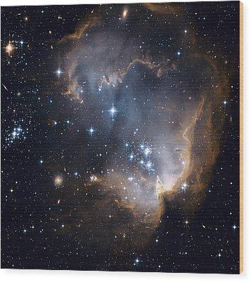 Bright Blue Newborn Stars Blast A Hole Wood Print by ESA and nASA