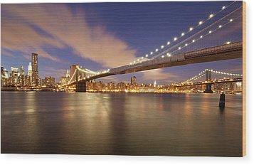 Brooklyn Bridge And Manhattan At Night Wood Print by J. Andruckow