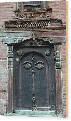Buddha's Eyes On Nepalese Wooden Door Wood Print
