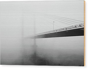 Cable Bridge Disappears In Fog Wood Print by Photos by Sonja
