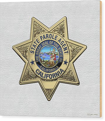 California State Parole Agent Badge Over White Leather Wood Print by Serge Averbukh