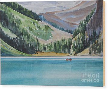 Canoeing-in-lake-louise Wood Print by Nancy Newman