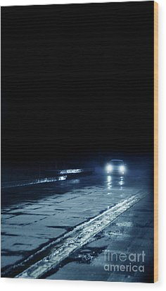 Car On A Rainy Highway At Night Wood Print by Jill Battaglia