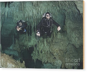 Cave Divers In Dreamgate Cave System Wood Print by Karen Doody