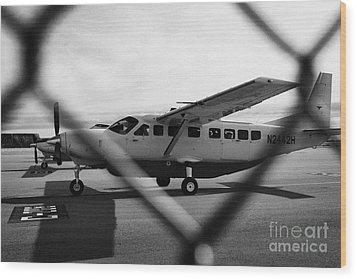 cessna 208B sightseeing tour aircraft at Grand canyon west airport Arizona USA Wood Print by Joe Fox