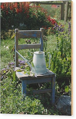 Chair And Watering Can Wood Print by William Thomas