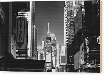 Challenges In Times Square Wood Print by John Rizzuto