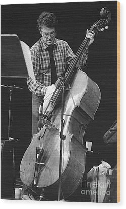 Charlie Haden Takes Care Of His Doublebass Wood Print by Philippe Taka