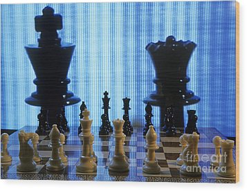 Chess Board With King And Queen Chess Pieces In Front Of Tv Scre Wood Print by Sami Sarkis