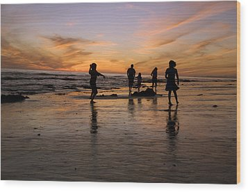 Children Playing On The Beach At Sunset Wood Print by James Forte